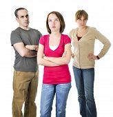 stock photo of disrespect  - Teenage girl rolling her eyes in front of angry parents - JPG