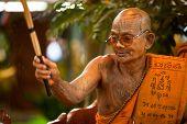 KO CHANG, THAILAND - NOV 28: Buddhist lama blesses participants Loy Krathong festival, Nov 28, 2012