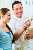 stock photo of spinal column  - Physiotherapist in his practice - JPG