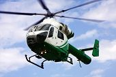 picture of rescue helicopter  - a helicopter in the air while flying - JPG