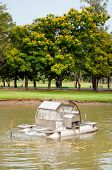 picture of aeration  - An aerator machine under operating in a park - JPG