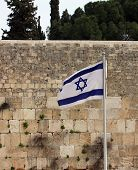 stock photo of israeli flag  - Israeli flag at the Western Wall Jerusalem Israel