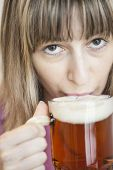 image of stein  - Attractive young woman drinking a stein of beer - JPG