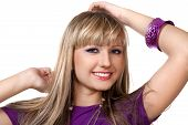 Beautiful girl in purple clothes with silver necklace