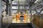 TOGLIATTI - SEPTEMBER 30: Passenger car hangs on assembly line at Avtovaz factory on September 30, 2