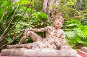 Sculpture of reclining angel in botanic garden