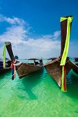 Tropical Beach Landscape. Thai Traditional Long Tail Boats At Ocean Gulf. Thailand