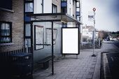 stock photo of bus-shelter  - Blank sign at bus stop for your own design