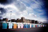 Long Row Of Beach Huts On Brighton Seafront, Brighton, England, Uk