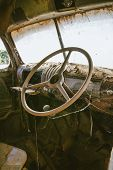 Old rusted truck steering wheel with spider web