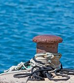 picture of bollard  - rusty bollard by the sea in Alghero - JPG
