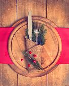 Knife and fork utensils in Christmas table setting