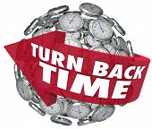 The words Turn Back Time on an arrow around a sphere of clocks to illustrate turning backward to redo or revise an action