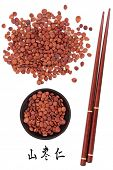 Jujube seed used in traditional chinese herbal medicine with mandarin title script translation and chopsticks.  Suan zao ren. Zizyphus spinosa semen.