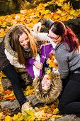 picture of prank  - Sisters play pranks and they have fun together on the park