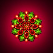 foto of rangoli  - rangoli with diwali diya elements over dark rouge background - JPG