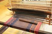Weaving Silk Fabric On A Large Handloom Near Angkor Wat, Siem Reap, Cambodia