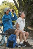 Senior Couple Hiking, Birdwatching And Camping