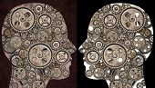 Profiles of two human heads filled with gears. Concept of communication