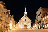 Street view with Notre-Dame des Victoires at night in Quebec City