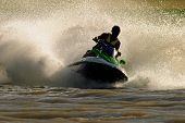 Backlit jet ski with water spray