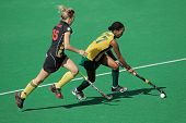 BLOEMFONTEIN, SOUTH AFRICA - FEBRUARY 7: C de Vos (L) and Leslie-Ann George (R) during a women's field hockey match between South Africa and Belgium, Bloemfontein, South Africa, 7 February 2011