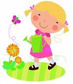 A cute little girl watering flower