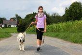 Girl Taking A Dog For A Walk