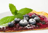 detail of cake with blueberry filling and with fresh blueberries, dusted with sugar