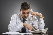 Successful Businessman Dialing On Phone