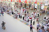 SAMARA, RUSSIA - JULY 7: Shoppers at the checkout lane Auchan hypermarket, July 7, Samara. In Russia