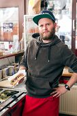 Hotdog joint - friendly salesman and fresh ingredients in a fast food eatery
