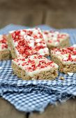 Strawberry And Meringue Topped Flapjack On Gingham Cloth