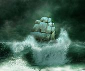 stock photo of old boat  - old ship sailing in the middle of a thunderstorm in an ocean with big waves - JPG