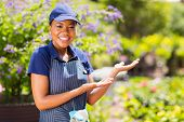 friendly african american nursery worker with welcome pose
