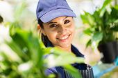 closeup portrait of young pretty garden worker in uniform