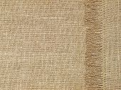 Linen Texture Pattern With Fringe As Background.