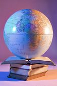 stock photo of midterm  - globe on books - JPG