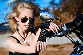 Young beautiful woman and bike