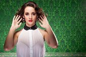 Fashion Woman Retro Style On Green Vintage Background
