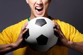 Excited Sport Man Shouting And Holding Soccer