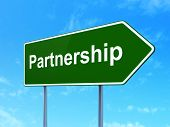 Business concept: Partnership on road sign background
