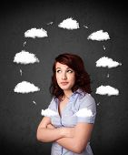 Thoughtful young woman with drawn clouds circulating around her head