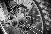 stock photo of motocross  - Close up monochrome fragment of front sport motocross bike wheel - JPG