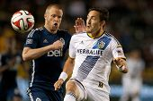 CARSON, CA - APRIL 12: Los Angeles Galaxy M Stefan Ishizaki #24 & Vancouver Whitecaps D Jay DeMerit