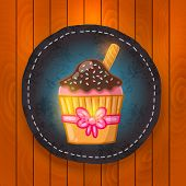 vector cupcake with chocolate cream.