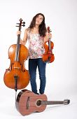 Girl With Double Bass,violin And Guitar