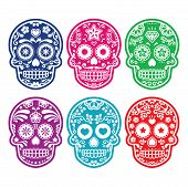 stock photo of sugar skulls  - Vector icon set of decorated skull in color  - JPG
