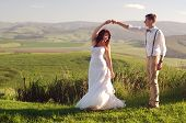 image of zulu  - Bride and groom outside garden wedding with African Natal Midlands mountain scenery background - JPG