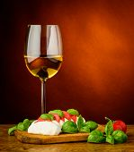 Mozzarella Cheese, Basil, Tomatoes And Wine